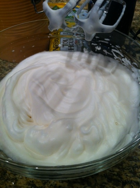 Beat egg whites, salt, cream of tartar, vanilla