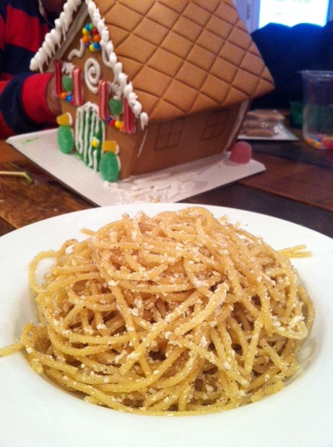 Holiday Myzithra Pasta! Simple, quick, light and very delicious! Perfect for the holidays....Mark decorating his side of the gingerbread house in the background :0)
