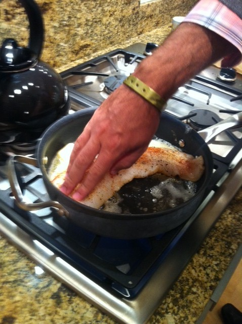 Pressing on the fish in a hot pan helps it not stick just FYI. Yeah that my all-inclusive bracelet :)