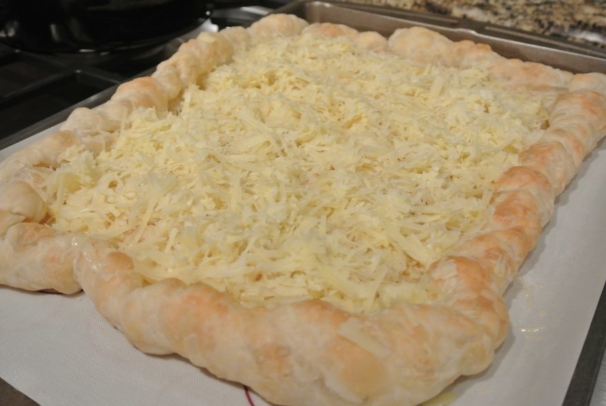 Shredded Gruyere on puff pastry